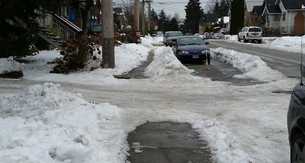 A common issue: Sidewalks cleared by homeowners cross un-plowed alleys.