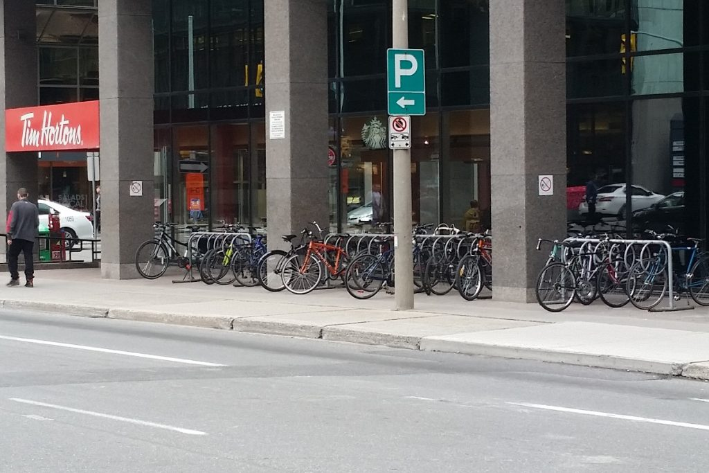 Downtown had lots of bike racks, and they were all bulging with bikes.