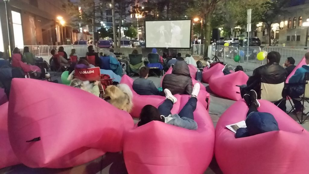 A cool use of public space in the Market area on a Friday night- Movies on the Street!